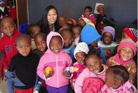Emily, with the children of J.S. Mokoka, a crèche in Mangaung.